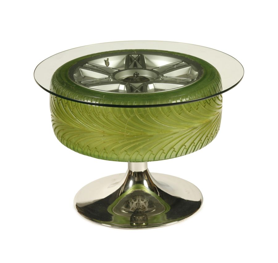green `goodyear eagle` tyre coffee table. the green tyre