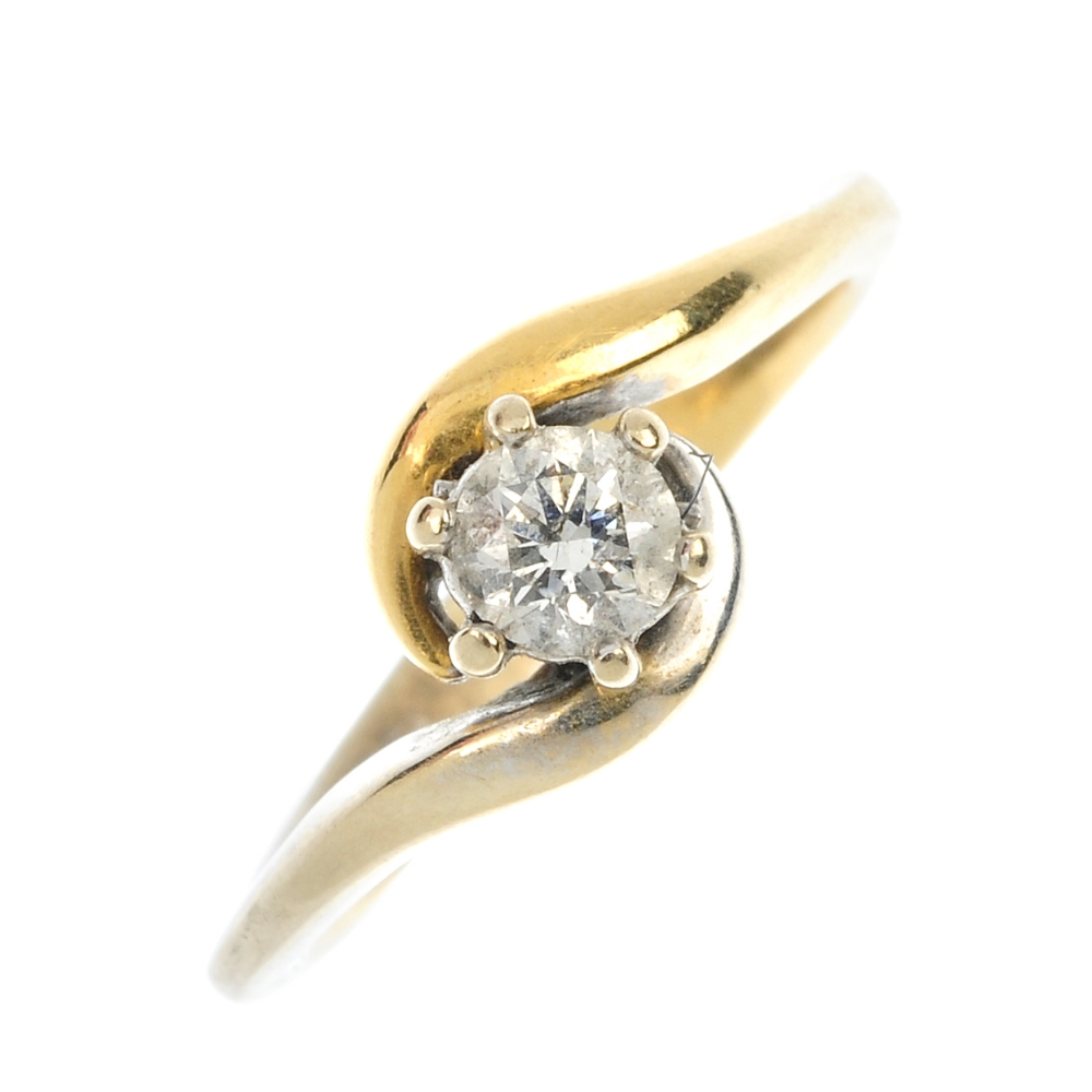 An 18ct gold diamond single-stone ring. Of bi-colour design, the ...