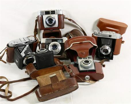 Collection of six cameras including a border, a Kodak Auto