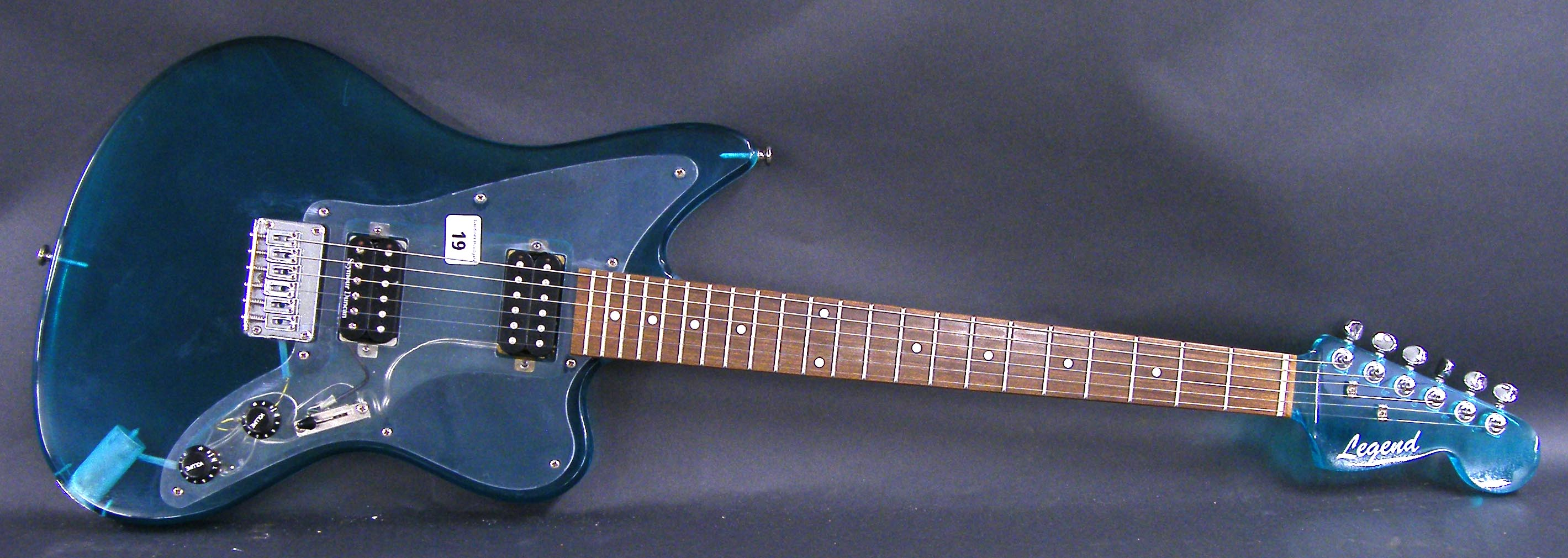 Lot 19 - Legend Jagmaster style Plexiglass electric guitar, clear turquoise Perspex finish with matching