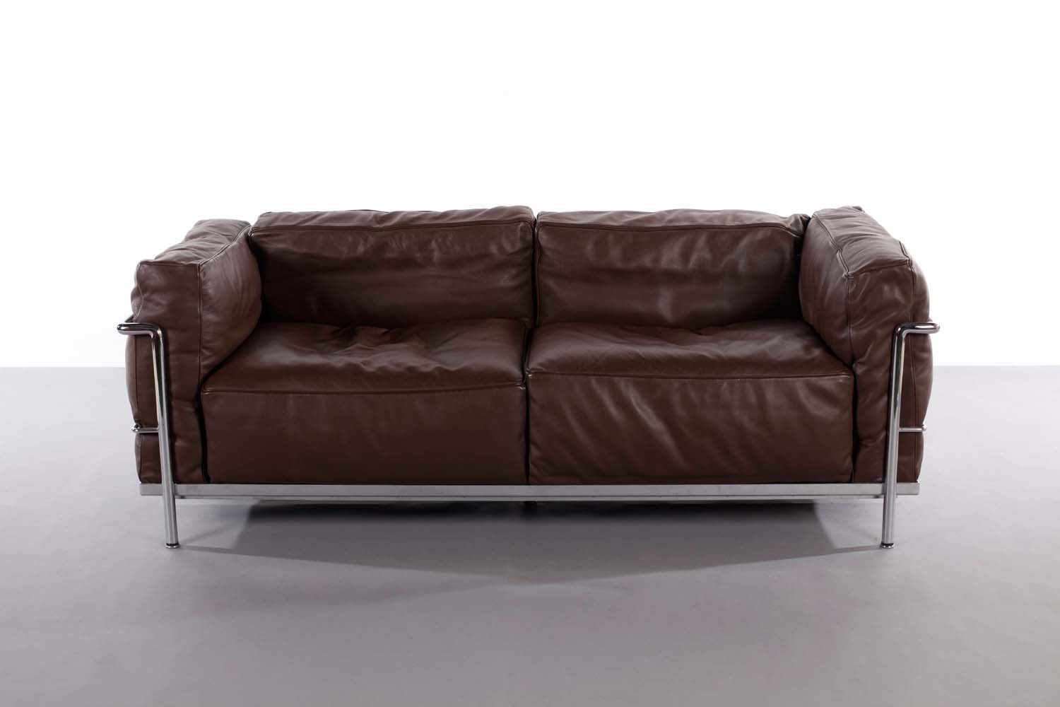 Lot 97   THE LC3 SOFA, BY LE CORBUSIER FOR CASSINA, In Dark Brown