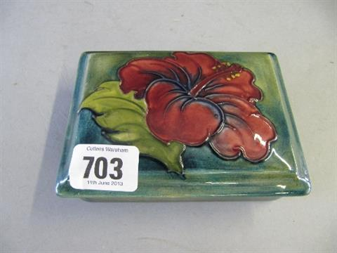 A Walter Moorcroft trinket box and lid decorated in the Red Hibiscus