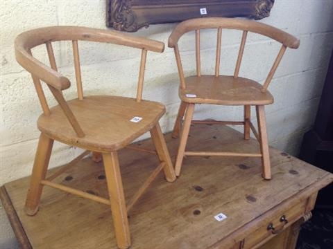 A pair of child\'s Vintage Herlag beech framed tub chairs.