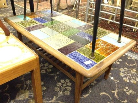 A Mid 20th Century Teak Framed Tile Top Coffee Table Decorated With Multi  Coloured Tiles With Mag