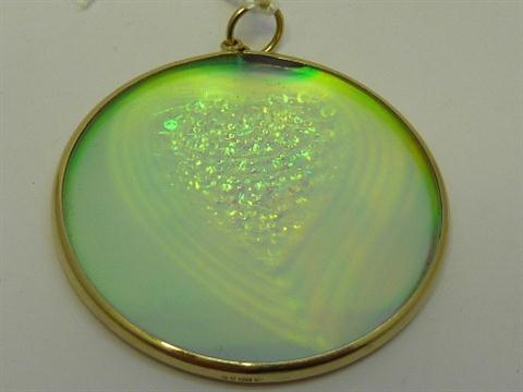 A 9ct gold mounted hologram pendant total weight 78gms aloadofball Choice Image