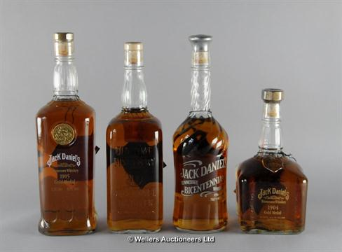 A collection of four Jack Daniels limited edition bottles