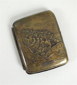A German World War I gilt metal cigarette case depicting