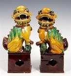 Lot 238 - Pair of Chinese pottery Dogs of Foo, each modelled seated on pierced rectangular base, painted in
