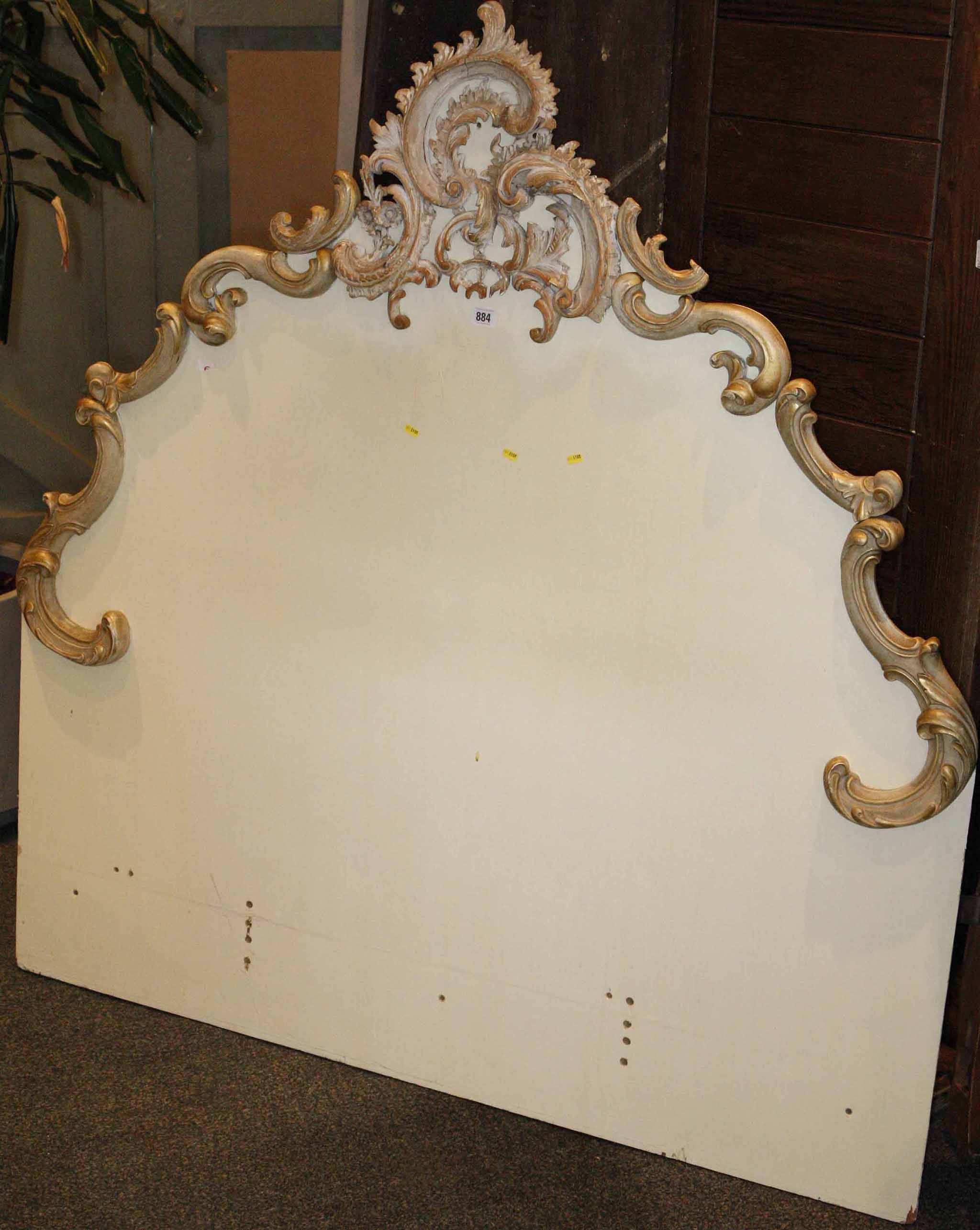 A cream painted and gilt single bed head board with carved rococo