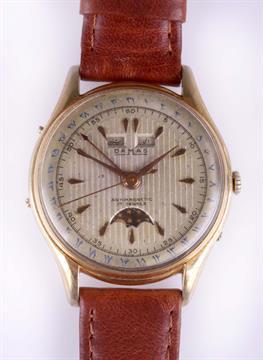 A gents vintage Damas triple date moon phase wrist watch