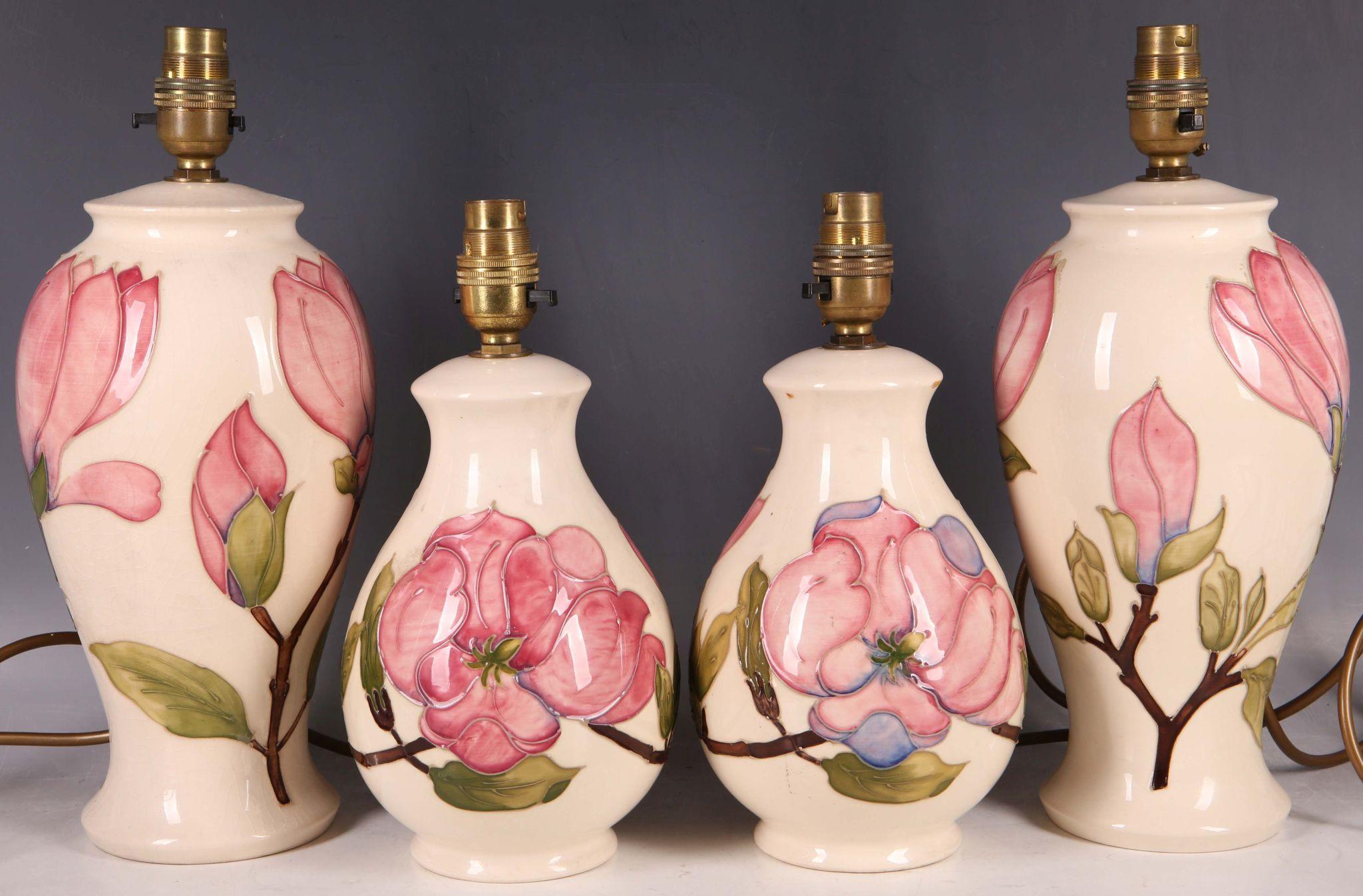 A pair of moorcroft pink magnolia contemporary tubeline baluster lot 281 a pair of moorcroft pink magnolia contemporary tubeline baluster vase table lamps aloadofball Choice Image