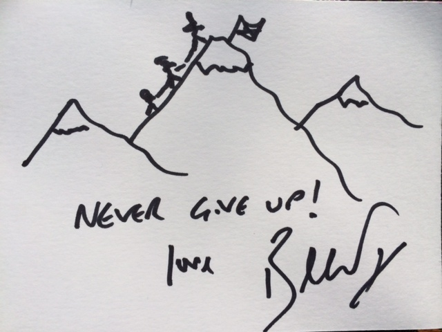 """Lot 57 - Bear Grylls """"Never Give Up!"""" Illustration of mountains with walkers reaching for the top. Pen on"""
