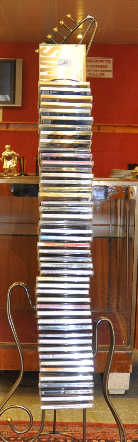 Lot 35 - GUITAR SHAPED CD RACK WITH CDS