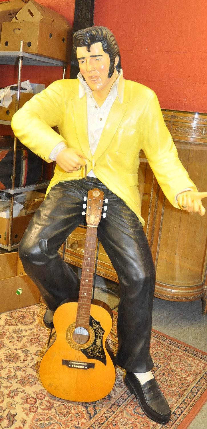 Lot 80 - LIFE SIZE FIGURE OF ELVIS PRESLEY ON A STOOL PLAYING A GUITAR, CONSTRUCTED FROM RESIN/FIBREGLASS