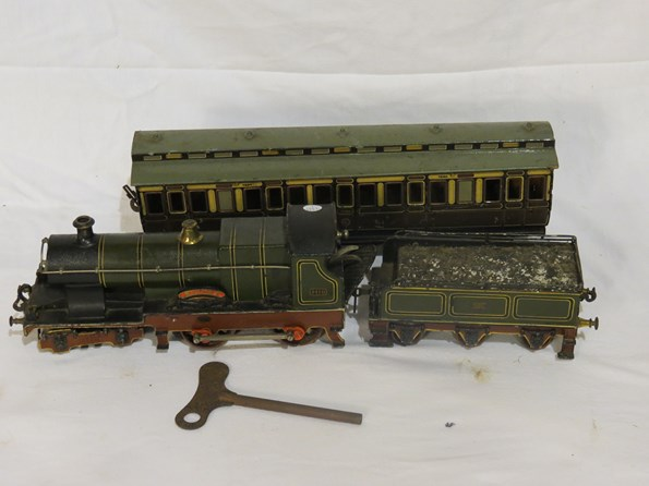 Lot 7397 - A gauge 2 Bassett Lowke 4-4-0 3410 'Sydney' clockwork loco with tender and carriage, with key