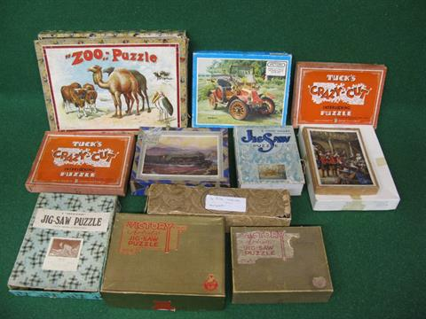 A quantity of assorted jigsaw puzzles to include 1908