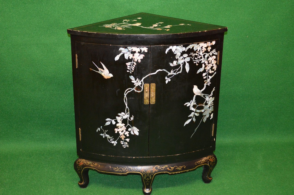A lacquered Oriental corner cabinet, the top being inlaid with ...