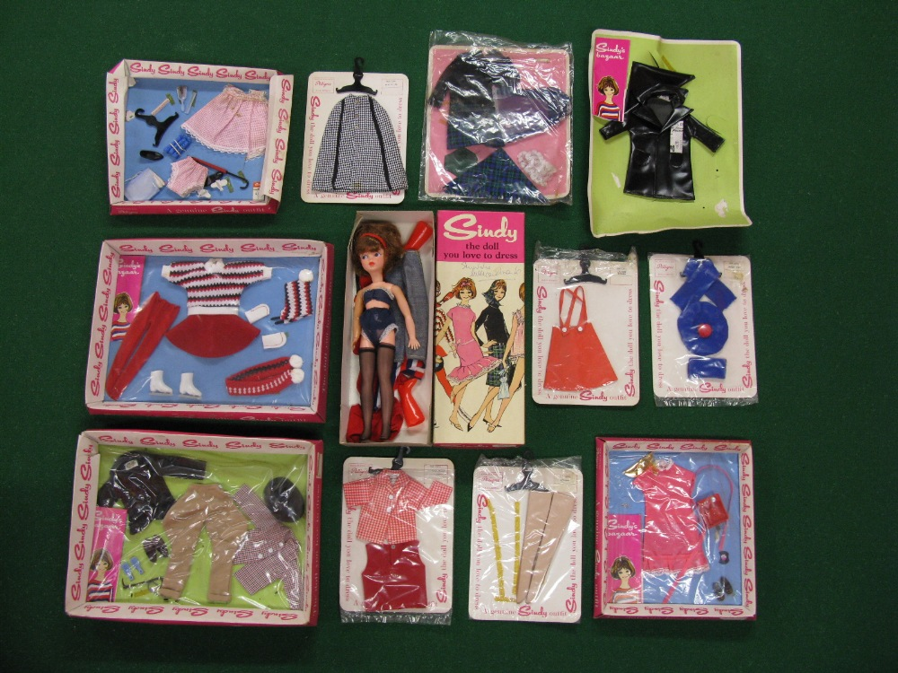 A quantity of Sindy clothing in tray and hanging packaging to include horse riding, skating and '