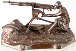 WWI SOLDIER INKSTAND. 3.25ins tall, 6.25ins long, white metal formed as WWI soldier with machine