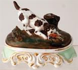 GAME DOG INKSTAND. 4ins tall, 5.5ins long ceramic inkstand, game dog with pheasant in its mouth