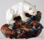 POLAR BEAR INKSTAND. 5.75ins tall, 7.5ins at base. Ceramic inkstand formed as a polar bear on