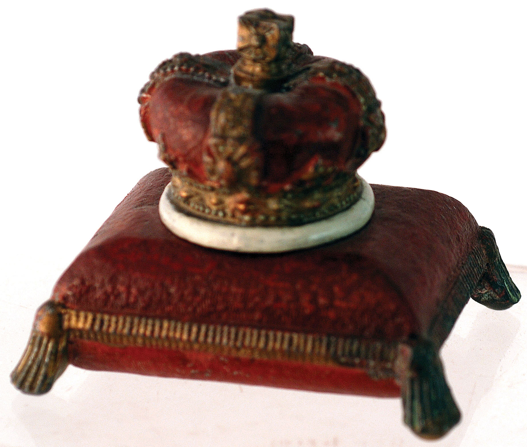 Lot 35 - CROWN ON CUSHION INKWELL. 2.75ins tall, metal inkwell formed as a crown on cushion. Red & gold