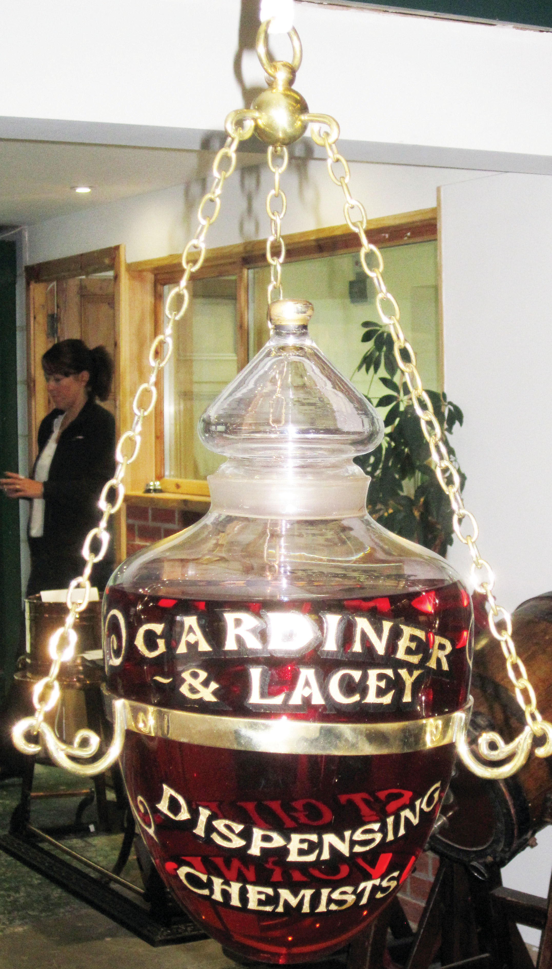 Lot 89 - NORWICH HANGING CARBOY. 16.5ins long, clear glass pear shape hanging carboy with stopper 'THE