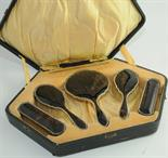 Silver mounted toilet set comprising a hand mirror & two pairs of brushes, with shaped moulded