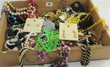 Quantity of beads & costume jewellery.