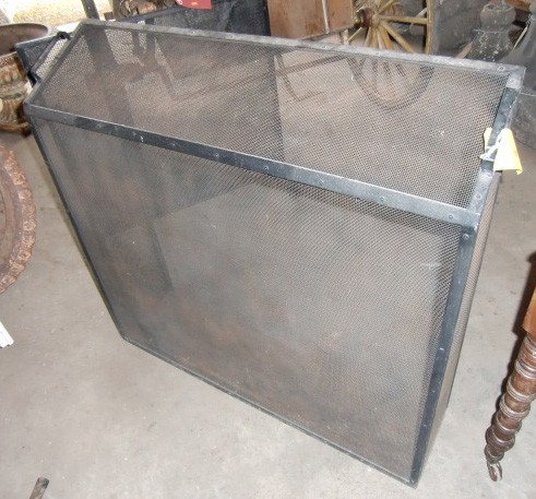 "Lot 22 - A very large iron box framed mesh Fire Guard, 40""w x 38""h. (1)"