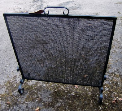 Lot 24 - An iron framed mesh Fire Guard. (1)