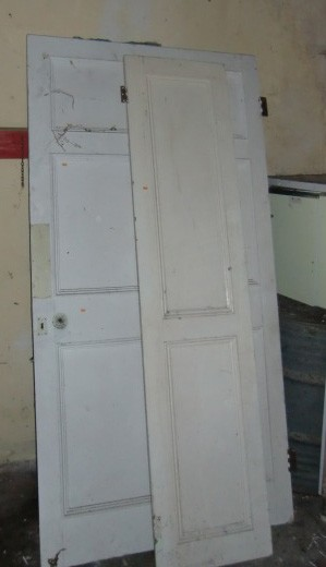 Lot 34 - A quantity of Panel Doors, Shutters and other Panelling. (a lot)
