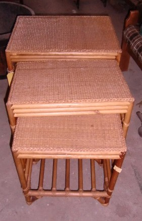 Lot 4 - A cane work nest of four Coffee Tables. (4)