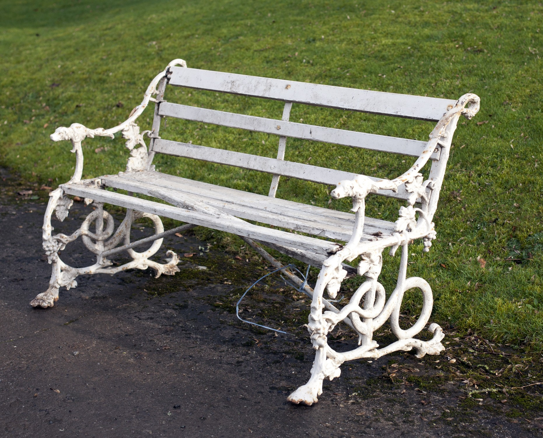 Lot 50 - A rare Victorian metal and wooden Garden Seat, with dog head handles and serpent supports, decorated