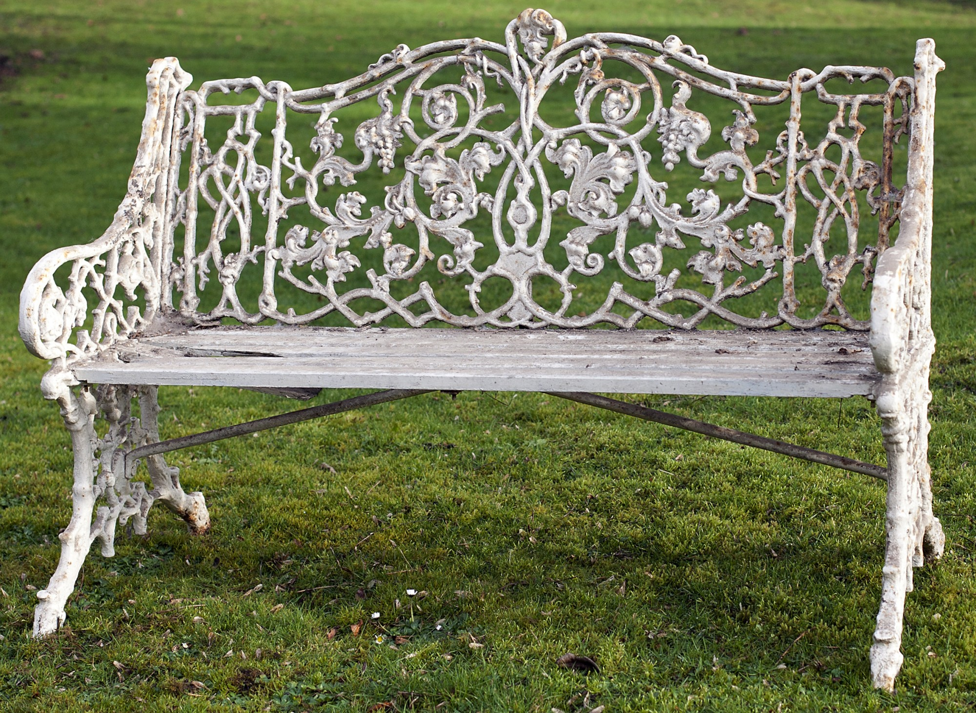 Lot 51 - A rare Victorian period Garden Seat, the elaborate pierced metal back and sides decorated with vines