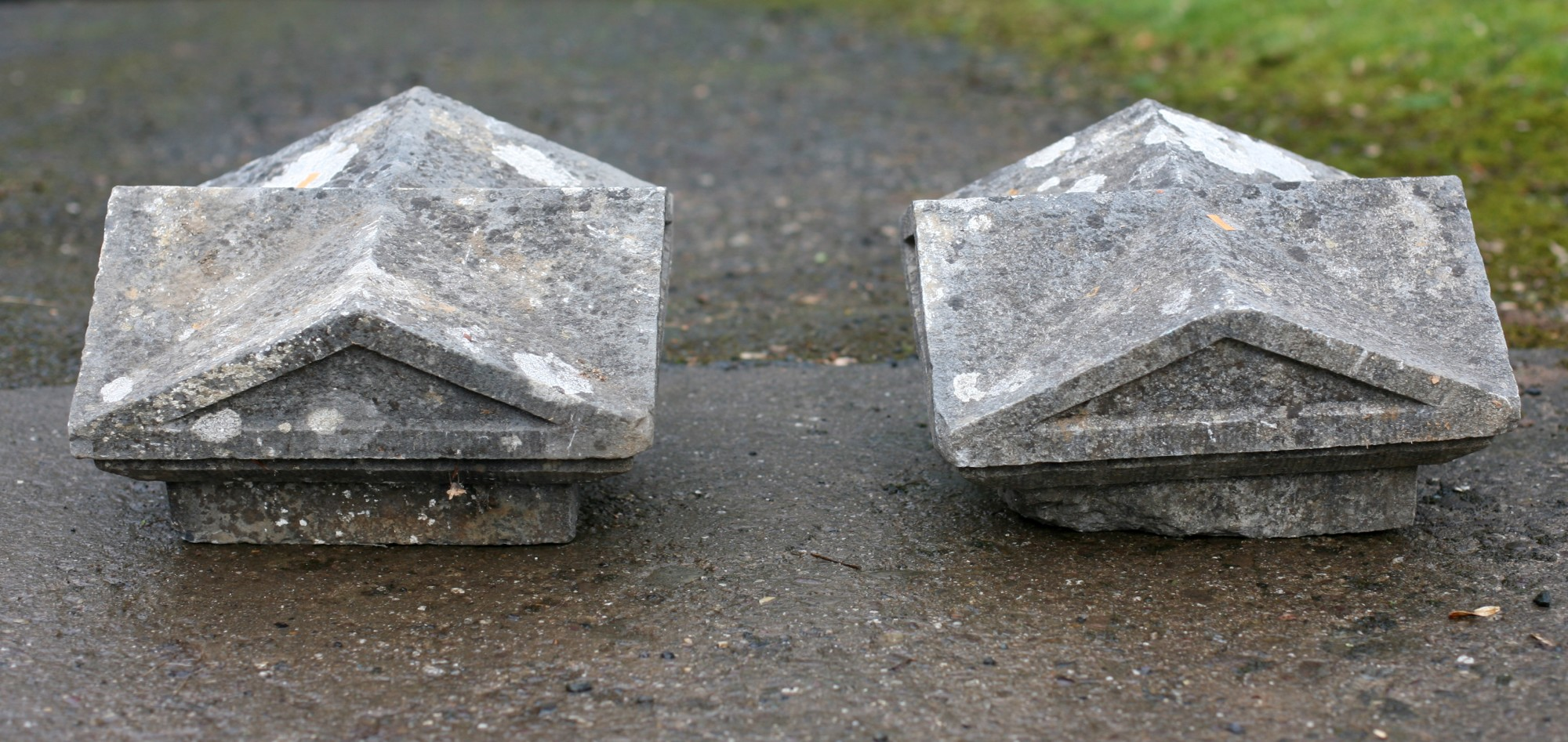 Lot 55 - A pair of carved square shaped limestone Pillar Caps. (2)