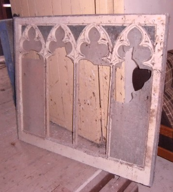 Lot 9 - An old pine Gothic design window, and a carved and turned oak Panel. (2)