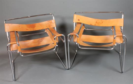 After Marcel Breuer, A Pair Of Wassily Style Easy Chairs, With Tubular  Chrome Steel Frames And Br