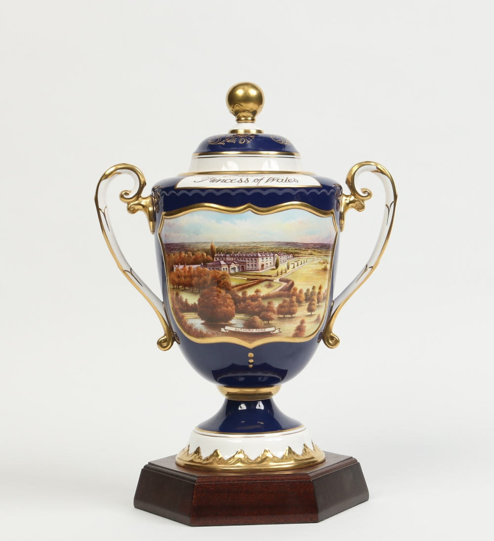 Lot 160 - A boxed Aynsley china memorial urn and cover raised on a mahogany plinth for Diana Princess of Wales