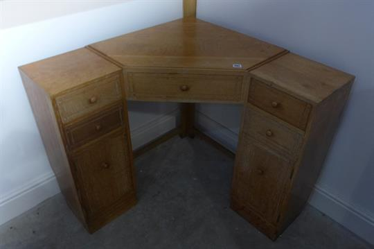 A Heal Son Ltd London Lime Oak Corner Dressing Table With Five Drawers And Two Cupboard Doors