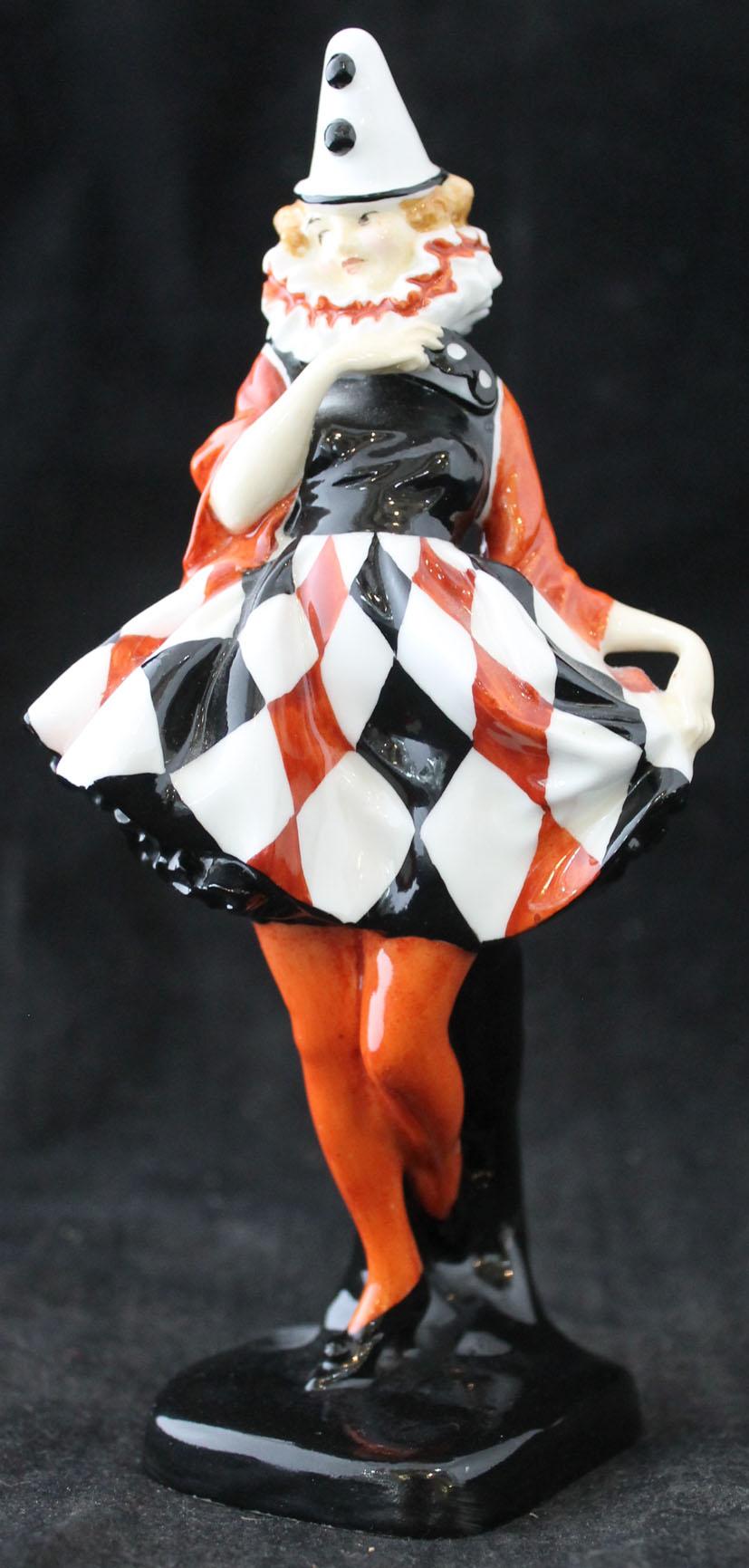 Lot 320 - A Royal Doulton figure 'Pierrette' HN643, designed by Leslie Harradine, green printed factory