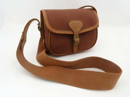 Lot 477 - Shooting   A canvas   leather cartridge bag by Brady