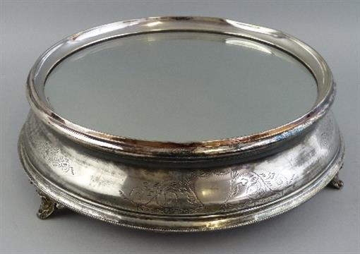 An Early 20th Century Silver Plated Wedding Cake Stand, Of Circular Form  With Mirrored Top Surfac