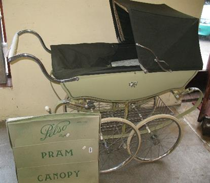 A Silver Cross Coach Built Pram In Two Tone Green With Folding Hood
