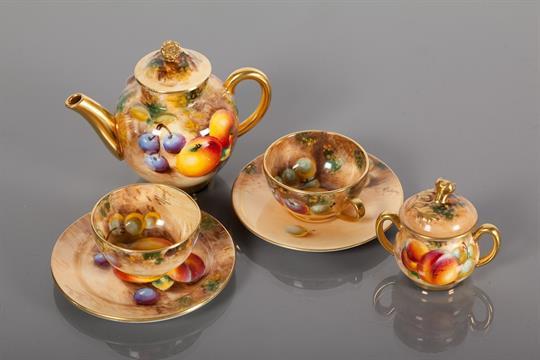 ROYAL WORCESTER MINIATURE TEA SET comprising a teapot, sugar, bowl ...