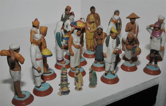 Nineteen Indian terracotta figures, various poses and status; two Chinese