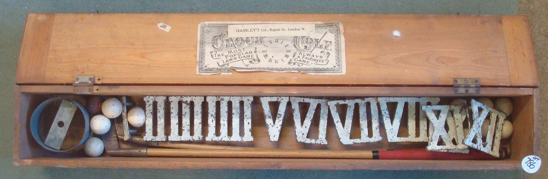 Lot 896 - Hamley` s Clock Golf Garden Putting Game: comprising 12 Roman numeral cast iron numbers 2 putters