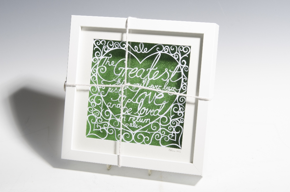 "Lot 1125 - Donated by Emma Blue, a handmade framed papercut incorporating the following quote - ""The greatest"