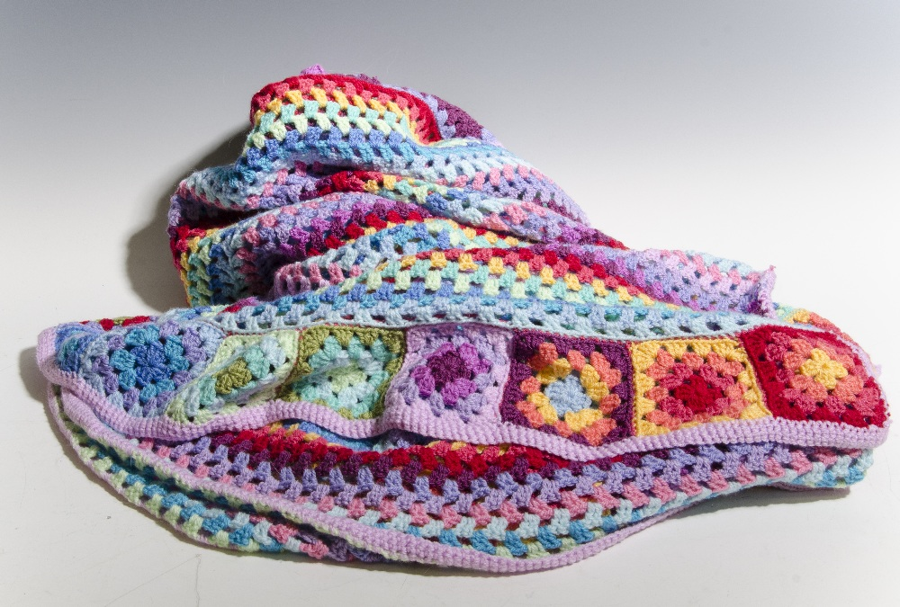 "Lot 2514 - Donated by Spans Studio, a colourful crochet blanket using acrylic yarn, 86"" x 68"" www.spanstudio."