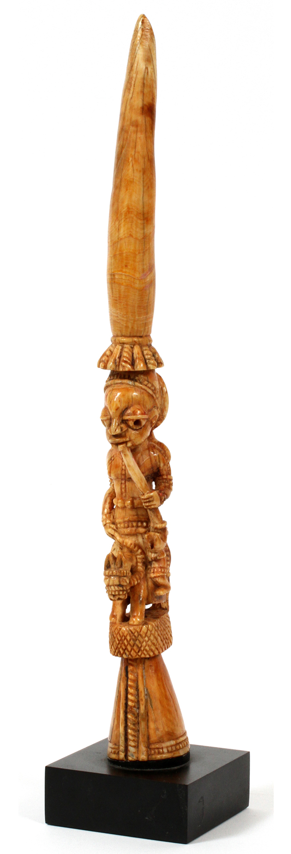 "Lot 144 - AFRICAN TRIBAL CARVED IVORY TUSK, L 12 1/4"": Depicting an elongated figure with pipe, riding a"